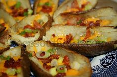 Loaded Potato Skins - baked to a crispy tenderness and filled with all the goodies we love - green onion, bacon, cheese and sour cream if you like.