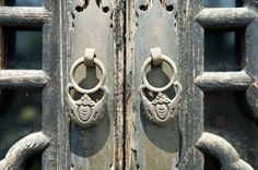Doorways to traditional chinese house with antique door knocker