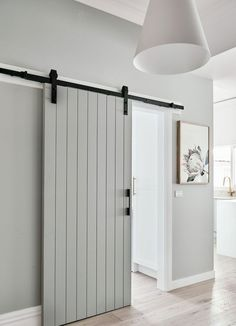 Unlike a standard hinged door that requires floor space to swing open, a sliding barn door takes up little more space than the thickness of the door. door ideas 17 design ideas for small hallways Diy Sliding Barn Door, Diy Barn Door, Bathroom Barn Door, Sliding Bedroom Doors, Closet Doors, Sliding Door Design, Sliding Door For Bathroom, Indoor Sliding Doors, Indoor Barn Doors