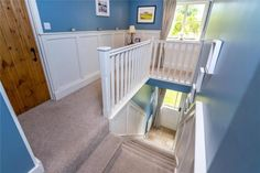 Renovated landing, installed window and landing by borrowing space from the bedroom. Exposed Brick Walls, Exposed Beams, Dulux Blue, Grey Painted Walls, Log Burning Stoves, Window Seat Storage, Multi Fuel Stove, Paved Patio, Wash Hand Basin