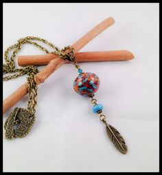 Feather Necklace turquoise , brown and gold Fimo polymer clay and bronze metal . - pinned by pin4etsy.com