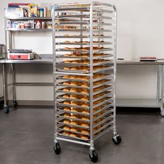 """Hold and transport a variety of your most popular baked goods with the Regency 20"""" x 26"""" x 69"""" end load bun pan rack! This bun pan rack can hold up to 20 full size sheet pans or 40 half size sheet pans - up to 350 lb. of total weight - with 3"""" of space between them, ensuring your foods can be stored safely. The whole rack ships unassembled so you save on shipping costs, and it's mounted on four 5"""" hard plastic  (two with locks). <br><br><b><u&..."""