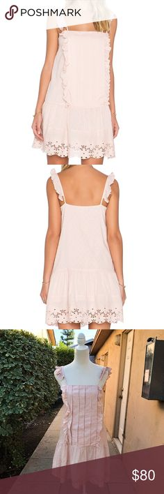 """Tularosa x Revolve Annabel Ruffle Dress Tularosa x Revolve Annabel Ruffle Dress Made exclusively for Revolve Color """"pale pink"""" Ruffled straps and accents Embroidered Eyelit hem Lined Some fuzzies stuck to the dots but it's hardly noticeable 100% cotton  Measurements (approximate): Bust: 17"""" Length: 26""""  No trades Offers welcome! Tularosa Dresses Mini"""