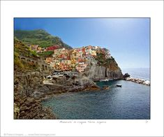 A tiny village of centuries old cottages perched above a turquoise sea...this is Manarola. This is the Cinque Terre. Click website or photo for more awesome photos.