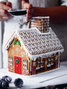 Whether it's a gingerbread house worthy of a Bake Off final or a beautiful biscuit wreath to hang on your door, these are impressive baking projects the whole family can get involved with. Homemade Gingerbread House, Gingerbread House Designs, Gingerbread Decorations, Christmas Gingerbread House, Christmas Mood, Gingerbread Cookies, Christmas Decorations, Gingerbread Houses, Gingerbread House Decorating Ideas