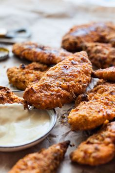 KFC Copycat Oven Baked Chicken Tenders - tastes just like KFC, with a crunchy coating, 11 Secret Herbs & Spices and a fraction of the calories!