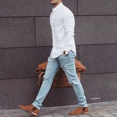 Mens style. White long sleeve collared shirt. light denim jeans. Tan boots.