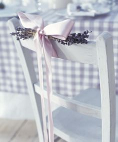 Chair ties hold lavendar to white chairs, used with lavendar and white large gingham check table cloth, would be pretty for spring lunch or wedding