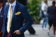 Pastel yellow necktie mixed with powder blue shirt and navy blazer, yellow pocket square