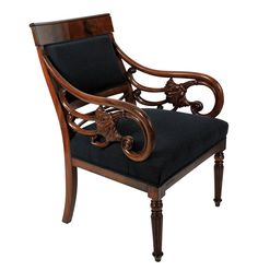 A fine Danish armchair in solid mahogany attributed to Gustav Friedrich Von Hetsch of Copenhagen (1788-1864). With beautfully carved open arms in a florid manner and turned reeded front legs. Newly upholstered in dark blue Paul Smith linen weave wool.