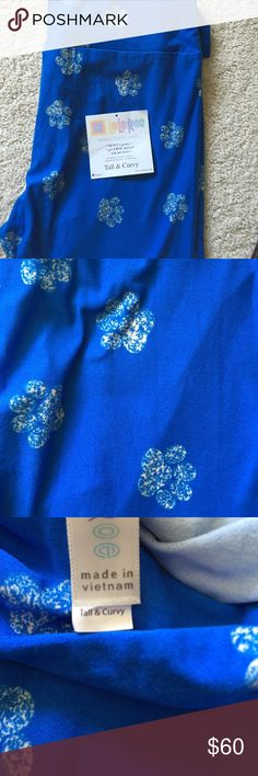 """*Unicorn* LuLaRoe TC Paw Leggings Royal blue with white paw LuLaRoe tall and curvy leggings.  Ended up with two pairs. Hard to find! Fits sizes 12-22. If you haven't tried these """"buttah"""" leggings, you have to, and if you have, you know what a great score these are! LuLaRoe Pants Leggings"""