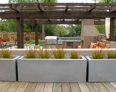 Planters juxtaposed against the wood deck - digging the combination.