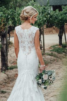Fit-and-flare wedding dress with illusion back by @allurebridals {Vitaly M Photography}