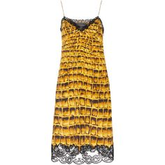 796b1cad6c0 This   Versace   Lace Trim Slip Dress features a v-neckline and a sheath  silhouette.