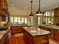Quite possibly the perfect kitchen! Humphrey Creek Rustic Home Kitchen Photo from houseplansandmore.com