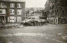 """A """"cornered"""" Tiger II tank in Germany, 1945. Its last stand, #222."""