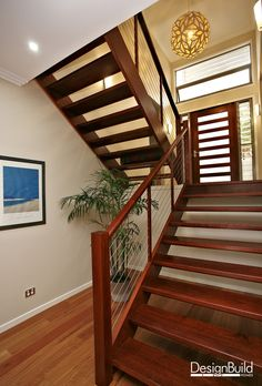 Interior staircase with feature pendant lamp.