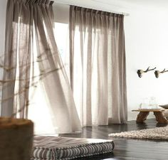 You can never go wrong with linen drapes. Beautiful yet functional.