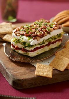 Layered Sundried Tomato and Artichoke Spread -- This appetizer recipe looks complicated to make, so we've included a video to prove to you that it's not!