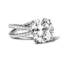 Brides.com: Round-Cut Engagement Rings Style 990741302, Tolkowsky 14K white gold .75 carat t.w. round-cut diamond ring, $2,899.99, Kay Jewelers  See more Kay Jewelers engagement rings.Photo: Courtesy of Kay Jewelers