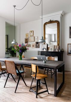 Dutch style dining room! Do you love eclectic interiors? This home combines all kinds of different interior styles, with vintage furniture and industrial touches #interiordesign #eclectic