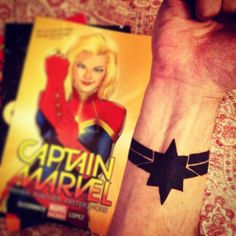 Ta da! It is the first of many. Captain Marvel is a huge inspiration to me and I am glad to carry her symbol around with me. I'll probably get a Ms. Marvel symbol (the lightning bolt) on my other wrist in the same spot to match.