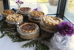 """Wedding pie on wood blocks, with """"pie topper"""" made out of driftwood and painted to look like Bride & Groom @Offbeat Bride"""