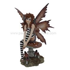 Naughty Fairy Figurine by Amy Brown   Fantasy art of Amy Brown Fairy Collection    This fantasy faery figurine features an earthy fairy wearing black and white striped tights, brown butterfly wings sitting on a spotted toadstool. Amy Brown's fairy figurines by Pacific Trading are handmade in cold cast resin, hand painted in acrylic, and highly detailed. These open edition fairy statues are 6.25 inches tall and will not be around for long.
