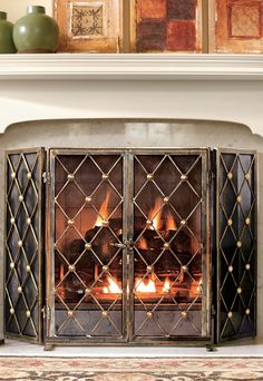 Our Byron Fire Screen & Tool Set beautify a simple hearth with masterfully crafted powdercoated iron and brass. The striking fireplace screen features double doors for easy access and thoughtful, handwelded design details.