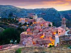 Albarracín sits perched high on a mountaintop above the Río Guadalaviar in the Spanish province of Teruel. Travelers will feel like they're stepping back in time as they explore the town's famed half-timbered houses, ragged fortress walls, and maze-like streets.