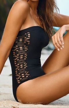 Black one piece swim suit with open cute pattern sides
