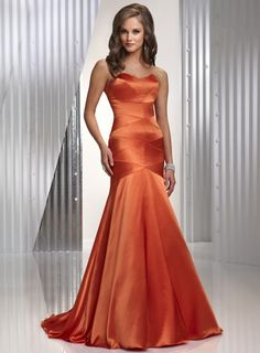 Mermaid orange evening dress, a simple and chic slinky satin fit and flare gown featuring exposed seams  throughout the bodice and a delicate scoop neckline. Burnt Orange, Purple, Royal, Canary