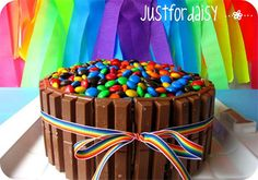 Love this cake!! - Blogger and creative Mum Rebekah from Just For Daisy  created a fun bright rainbow-themed birthday party for her daughter Scarlet's first birthday. There are so many great ideas, including the Kit Kat and Smartie-topped layer cake. Yum!