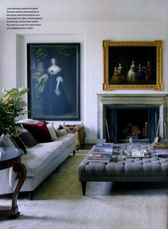 Love this tufted coffee table ottoman and the deep couch with cushy throw pillows.  And the art is SO dramatic!