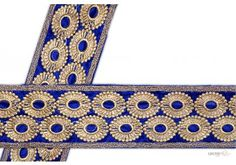 This awesome design is of Embroidery Trims . Its product code is: 001026 , Its size is: 70 mm. Material used is 100% Polyester . This Embroidery Trims comes with Embroidery , Sequence decoration. As seen design pattern is Circle . Locally this lace is also known as Saree Border . This orange embroidered trim item have 1 colors available in this design. This lace can also be used in Saree Border etc.