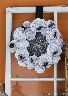 Creepy insect wreath.  We simply spray painted plastic insects and then glued them all over.