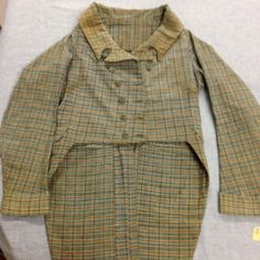 "1967.13.17, ""Stonington Plaid"" linen check coat, 1800-1810. Gift of Mrs Muriel Buckley, URI Textiles Collection."