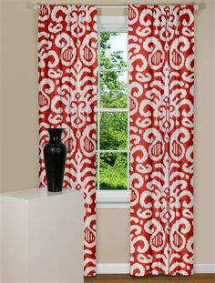 Ultrachic Ikat curtain panel with a soft white background against a bold red background. Draperies may be ordered unlined or lined.