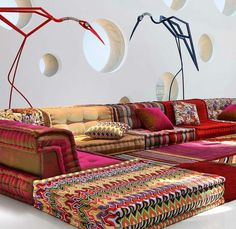Interesting and Awesome Moroccan Floor Seating : Beautiful Color Combination Floor Seating With Excellent Color Cushions Also Two Big Animal Shape Decoration And Uncommon Design White Walls