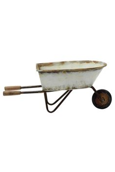 """This cute wheelbarrow decoration really makes a fun addition to any garden or perhaps a covered porch. You could even use it next to an old fashioned claw footed tub to create a fun farm style theme in a bathroom. Made by Creative Co-op, this wheelbarrow is made of metal with a distressed finish. It is only intended for decorative purposes, so don't try hauling bricks with it!    Measures 23.25"""" long by 10"""" tall by 10.5"""" wide.   Decorative Wheel Barrow by Creative Co-Op. Home & Gifts - Home…"""