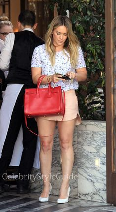 Seen on Celebrity Style Guide: Hilary Duff wore this anchor print tee and peach leather mini skirt as she enjoys lunch after a good workout at Cecconi's in Beverly Hills February 21 Get It Here: http://rstyle.me/n/fw2immxbn
