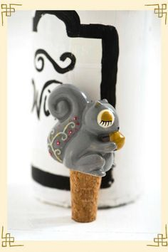 I have the salt and pepper shakers of this kind! I need the wine stopper!!