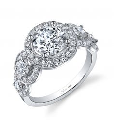 Style #SY878  1.50 Carat Engagement Ring    This stunning 18K white gold diamond engagement ring features a 1.5 carat round brilliant center diamond. Accentuated by surrounding round diamonds and diamonds on a beautifully designed shank diamond engagement ring. All enhancing the center diamond. It contains a total 0.99 carats.