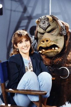 mykillyvalentine:  Carrie Fisher with a starstruck Gamorrean, c. 1983.