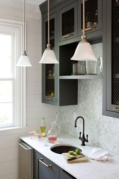 Cabinets painted in Benjamin Moore Millstone Gray - love this color with the antique brass hardware.