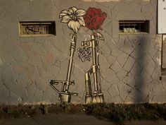 Flowers in gun barrels, courtesy of an #Austin #graffiti #artist.