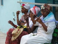 (CUBA) these old ladies dress up like that and sit on a bench of some corwded havana street and demand 1 peso to be photographed. if you don't pay they start shouting