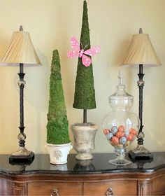 Cheap, easy, but beautiful Easter decoration. DIY tall poster board moss covered topiaries. Genius!