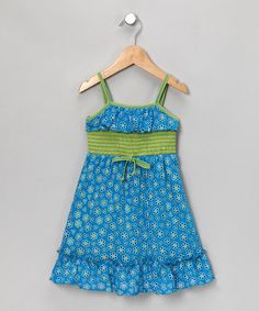 Old-fashioned eyelet is infused with color in this fun, bold dress. Vibrant hues peek out from the daisy cutouts while a ruffle rounds out the top and delicate straps hold it in place.62% polyester / 33% rayon / 5% spandexMachine wash; hang dryMade in the USA