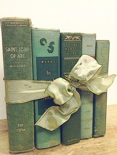 vintage books tied together with bow...love this idea...also vintage cookbooks tied together maybe with gingham bow.......